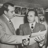 Gangster Johnny Rosselli (Right) Checks a Writ of Habeas Corpus with His Lawyer  Frank Desimone
