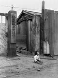 South Korean Child Sits Alone in the Street in Inchon  Korea