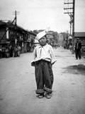 A Korean Orphan Boy Adopted by a Motor Pool Battalion at Inchon  Korea