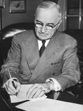 President Harry Truman at His Signing a Proclamation Declaring a National Emergency