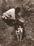 Man Burying a Child in a Shallow Grave in a Rural Hengyang or Yunnan Province  China