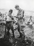 US Soldier of Lights a Cigarette for a Former Enemy Guard