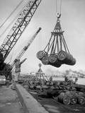 Fuel Drums are Lifted and Moved with Cranes from a Tanker at Inchon Harbor  Korea  March 7  1952