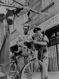 British Soldiers Examining Papers of an African Cyclist at Gunpoint  in Nairobi  Kenya  1953