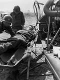 Wounded US Soldier Lifted onto a Helicopter for Evacuation to a Base Hospital