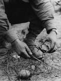 US Soldier Dismantles a German Booby Trap Planted on the Road to St Gilles