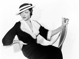 Sylvia Sidney in Black Matlasso with Collar and Cuffs of White Faille and Mexican Poon Hat  1934