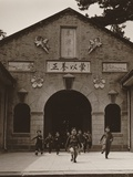 Children Running Out the Entrance of a School Building in China