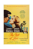 The Gift of Love  from Left: Robert Stack  Lauren Bacall  Evelyn Rudie  1958