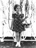 Shirley Temple  Modeling a Red  White and Blue Print Dress with a Blue Velvet Bow  Ca 1936