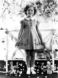 Shirley Temple  Modeling a Spring Frock of Shantung with Hat-Shaped Buttons  Ca 1936