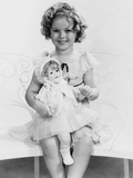 Shirley Temple  with a Shirley Temple Doll  Ca 1935