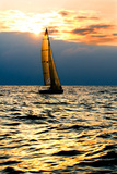 Sports Yacht in the Sea at Sunset