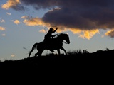 Cowboy in Silhouette with Sunset