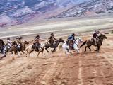 Cowboy's in Motion across the Field
