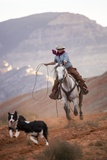 Cowgirl at Full Gallop with Cowdogs Leading Way