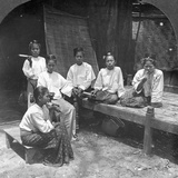 Burmese Women Smoking Outside their Home  Mandalay  Burma  1908