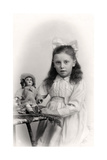 A Young Girl Holding a Doll  20th Century