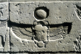 Limestone Relief of a Scarab Beetle and Vulture Wings under a Disk of the Sun  Edfu  Egypt