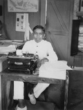 A Young Man Sitting at a Typewriter  Indonesia  20th Century