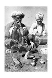 Charming the Venom from a Cobra; a Snake Charmer with a Mongoose  India  1922