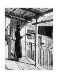 Monk Sounding the Call to Prayer on a Gong  Greece  1936