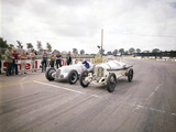 A 1914 and 1937 Grand Prix Mercedes Racing Cars at the Starting Line