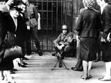 Civilians in Front of a German Guard Post with a Machine Gun  Paris  June 1940