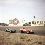 Two Racing Cars Taking a Bend  Dutch Grand Prix  Zandvoort  Holland  1959