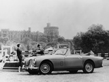 An Aston Martin DB2-4 MKII  with Windsor Castle in the Background  1956