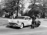 An Oldsmobile at the Corner of an American Street  1954