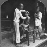 A Chinese Barber at Bhamo  Burma  1908