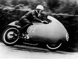 Possibly Bill Lomas  on a Moto Guzzi V8  1957