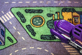 Purple Toy Car on Street Mat