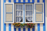 Window of a Traditional Striped Painted House in the Little Seaside Village of Costa Nova  Portugal