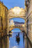 Italy  Veneto  Venice Bridge of Sighs Illuminated at Dusk with Gondolas