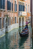 Gondola Boat Passing Through a Narrow Canal  Venice  Veneto  Italy
