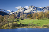Autumn Colours Beside Loughrigg Tarn with Views to the Snow Dusted Mountains of the Langdale Pikes