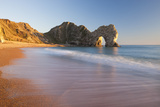 Waves Sweeping onto the Deserted Beach at Durdle Door  Dorset  England Winter