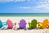 Adirondack Beach Chairs on a Sun Beach in Front of a Holiday Vac