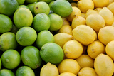 Pile of Fresh Yellow Lemons and Green Limes at Farmer's Market