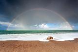 Big Colorful Rainbow over Ocean