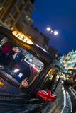 England  London  Knightsbridge  London Taxi on Brompton Road  Dusk