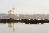 Coquille River Lighthouse in Morning Fog in Bandon  Oregon  USA