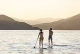 Paddleboarding on Whitefish Lake at Sunset in Whitefish  Montana  USA