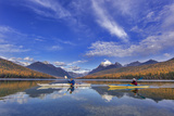 Sea Kayaking on Bowman Lake in Autumn in Glacier National Park  Montana  USA