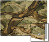 Swirling Patterns of River Runoff Mingling with Coastal Sands