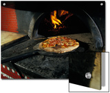 Pizza Comes Out of a Brick Oven in a Restaurant in Rome  Italy