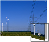 Windmills and High Voltage Transmission Lines in a Clear Blue Sky  Mecklenburg-Vorpommern  Germany