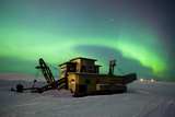 Green Northern Lights Dance over a Historical Gold Dredge Near Nome  Alaska
